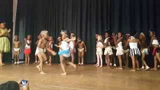 Cute 6 year old white girl doing a traditional Tswana Dance