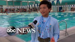 10-year-old breaks Michael Phelps' record in the 100-meter butterfly