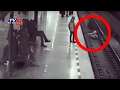 Caught on CCTV: Man pulls boy from rail track moments before train arrival