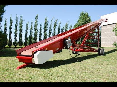Cinta transportadora plana Bec-Car CPA-1700.60 moviendo bolsas de azúcar