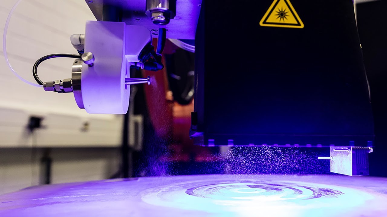 Inline testing of the wettability of material surfaces
