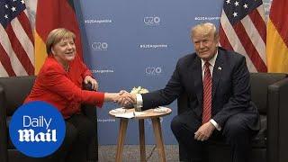 Trump and Merkel meet at G20 to talk trade and George H.W. Bush