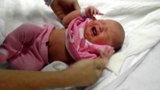 Newborn Baby girl getting dressed leaving hospital