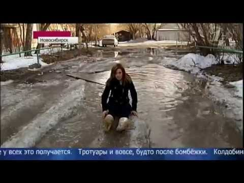 Russian Reporter Tries Hard To Jump A Puddle