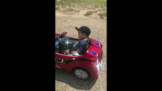 Little Boy Cannot Keep His Eyes Open While Driving His Toy Car