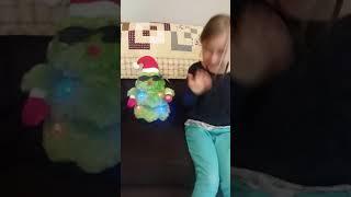 Christmas tree sings Jingle Bells with air guitar accompaniment
