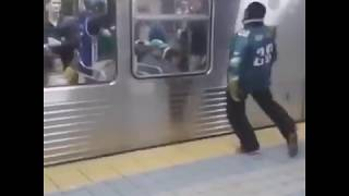 Both Angles Of The Philadelphia Eagles Fan Running Into A Subway Station Pole (EPIC FAIL)