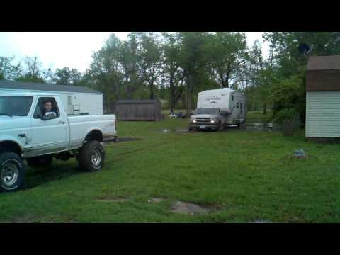 Ford F150 pulls out stuck Chevy 2500 with camper