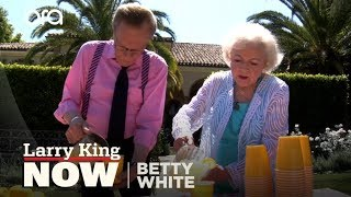 Larry King and Betty White open a lemonade stand in Beverly Hills.
