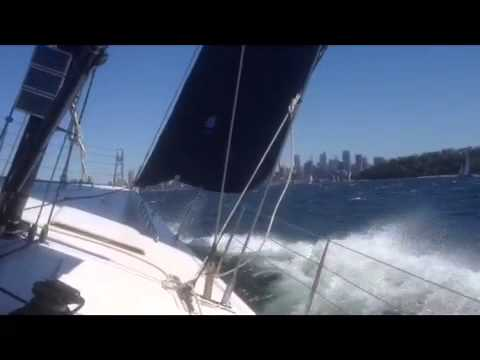 Sailing AC yacht on Sydney Harbour