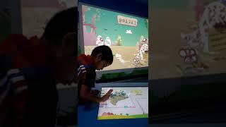 My son Shantanu exploring drawing app at a park, Singapore