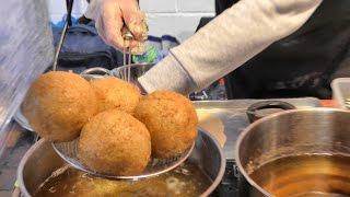 "London Street Food. Hand Made Italian Rice ""Arancini"" cooked in Brick Lane"