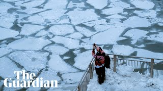 Polar vortex: -46C temperatures as Chicago River turns to ice