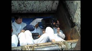 Crew Shoots Inside Trash Compactor
