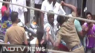 In video, 3 cops seen thrashing family as people watch..