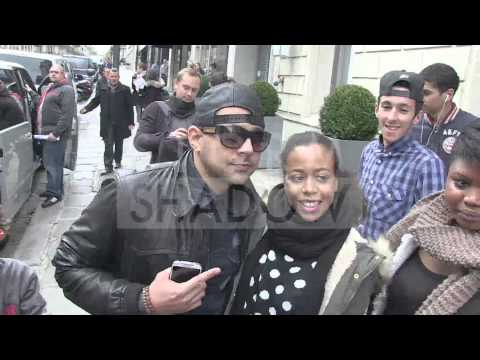 Sean Paul greets fans outise the Sers hotel in Paris