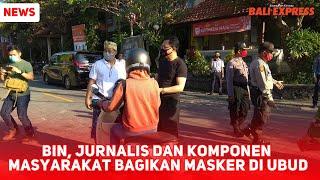BIN, Jurnalis dan Komponen Masyarakat Bagikan Masker di Ubud