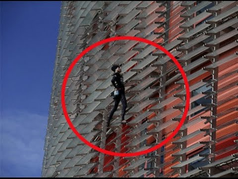 Watch : Man climbs Barcelona skyscraper without harness