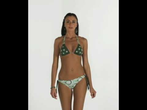 Slim athletic model wears Brazilian bikini Traira23