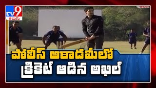 Akhil plays cricket with police training members..