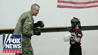 Deployed dad surprises son at Taekwondo practice