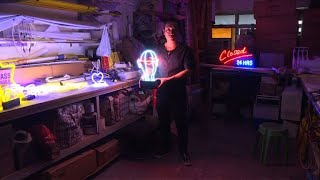 Disappearing jobs: neon sign maker shines bright in Hong Kong