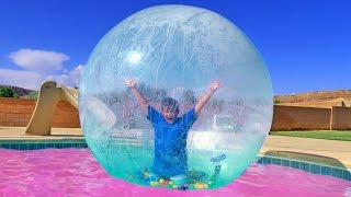 Silly TRAMPOLINE TRICKS Playing INSIDE GIANT BUBBLE BALL INTO SWIMMING POOL! Carl and Jinger