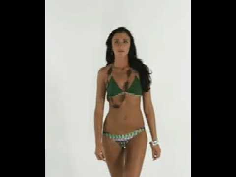 Slim athletic model wears Brazilian bikini Skin 03