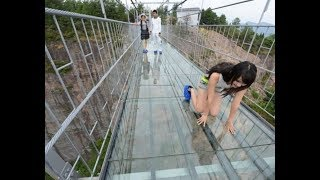 Tourist terrified by new glass walkway that cracks under weight in China