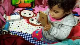 Aavya trues to explore and play with phone - 11 months 20 days
