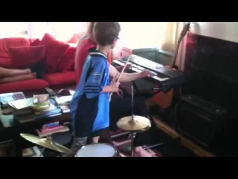 Charlie shows his groovy skills on the drums, and then switches to play his improvised melody on the piano (cousin on rhythm, dad on guitar)