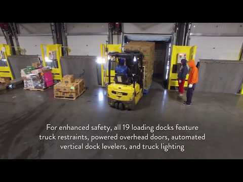 """Sid Wainer & Son®'s total cooler space now stands at over 100,000 sq. feet with the opening of the new facility. The new 56,000 sq. feet of cooler space holds three separate temperature zones, voice recognition order processing, access point defense, self-navigating forklifts, a fully integrated """"smart"""" loading dock, and 50,000 sq. feet of solar panels to compliment the company's dedication to environmentally friendly practices and sustainability."""