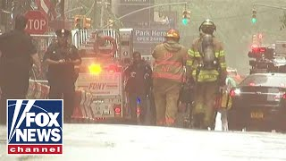 FDNY responds to call of helicopter crash into building in Manhattan