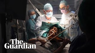 Woman plays violin while undergoing brain surgery..
