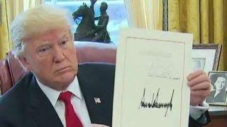 Trump signs tax bill