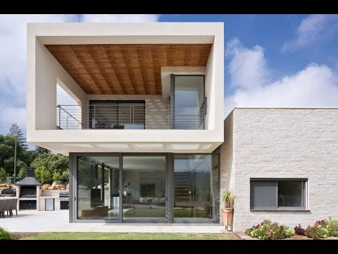 Contemporary House Created by Two Boxes Located Opposite Each Other and Built on Sloping Topography