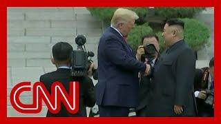 Trump and Kim Jong Un shake hands at DMZ
