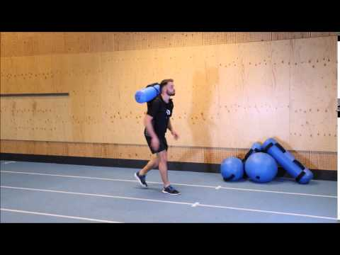 Forward hop with Medicine Ball Catch and Throw with Hydrovest®
