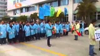 عمال مصنع أي بي ام في الصين يضربون بشأن صفقة لينوفو