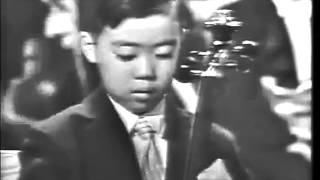 Leonard Bernstein presents 7-year-old Yo-Yo Ma's high-profile debut for President John F. Kennedy
