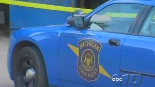 Man kicks window out of police car