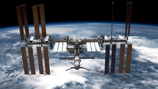 Astronauts Conduct Spacewalk Outside International Space Station | NBC News