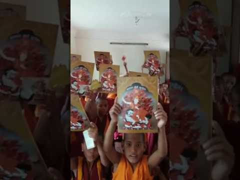 See how happy these young monks are with their gifts!