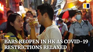 Hong Kong further relaxes Covid-19 restrictions but officials warn of resurgence