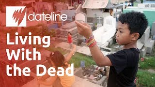 Why are Filipino communities living in cemeteries and caring for its dead?