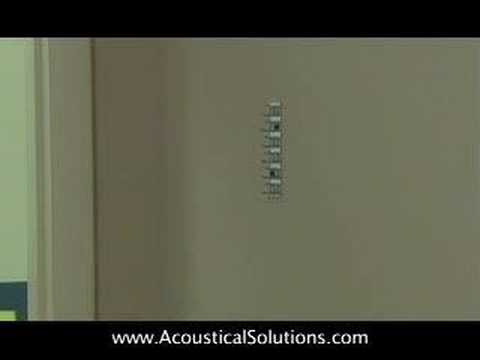Acoustical Wall Panel Installation using Impaling Clips and adhesive