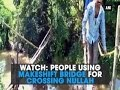 Watch: People using makeshift bridge for crossing nullah