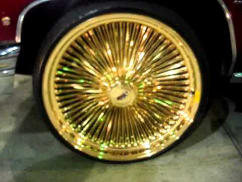"""1976 CANDY APPLE RED CAILLAC ON 24"""" ALL GOLD DAYTONS RIMS ..."""