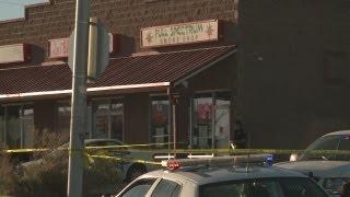 Dead robber's widow sues shop clerk