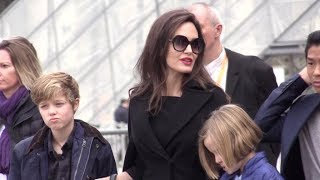 Angelina Jolie brings the all family to the Louvre Museum in Paris